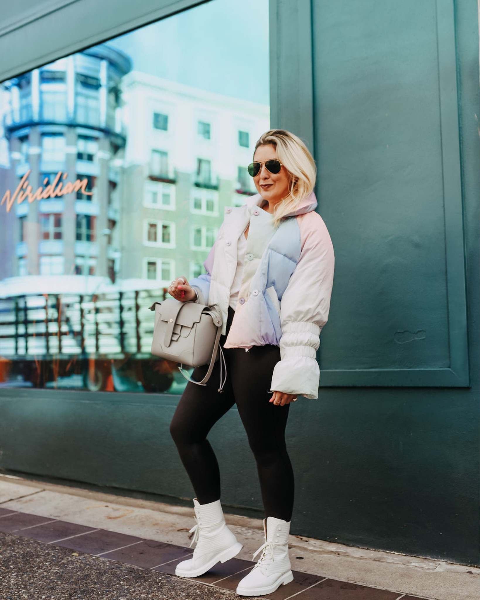 Katwalksf wearing a rainbow ombre puffer and spanx leather leggings in Oakland.