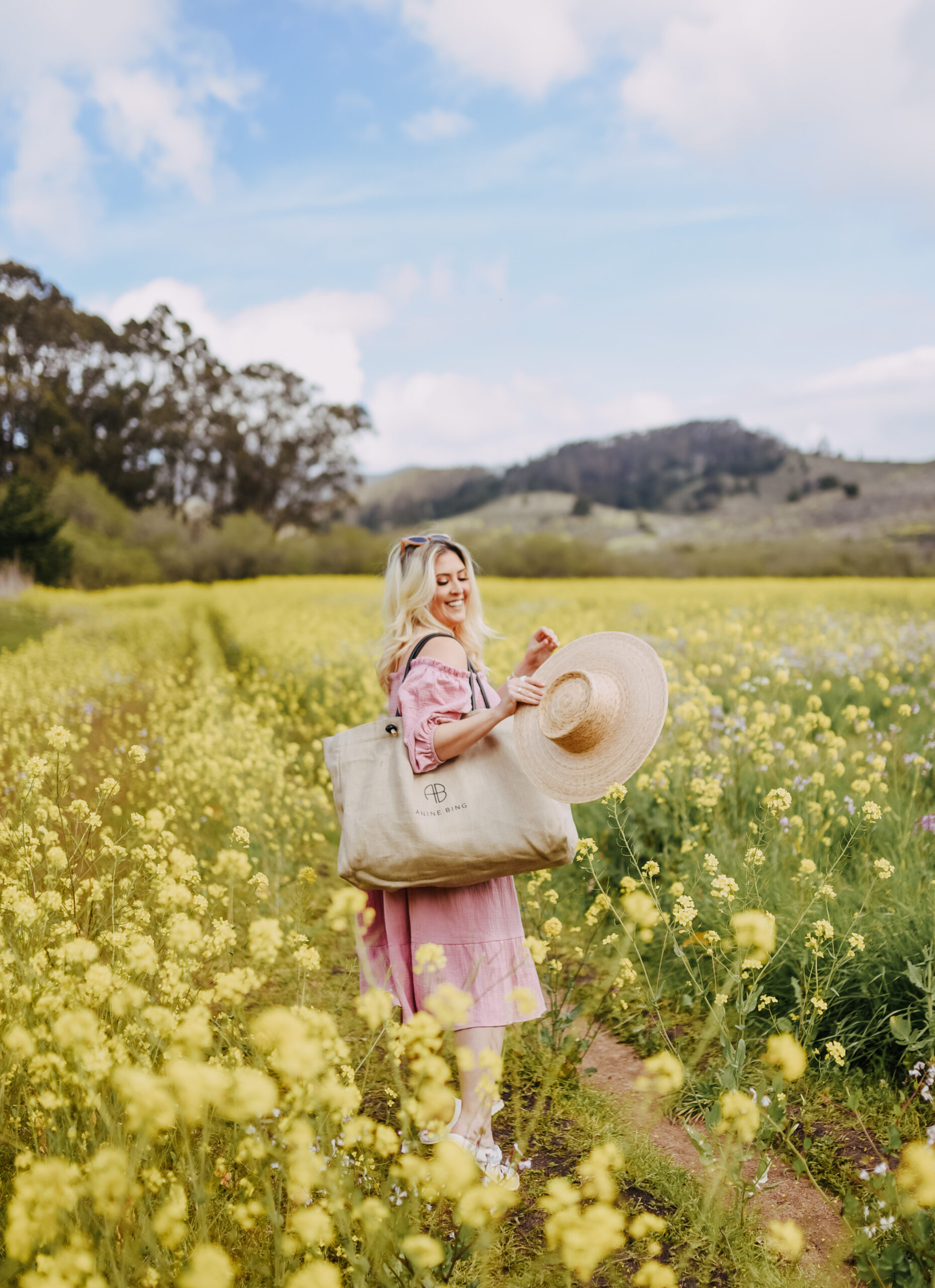 Fashion blogger Kat Ensign KatWalkSF wearing the a nap dress and the Anine Tote in the Half Moon Bay Superbloom