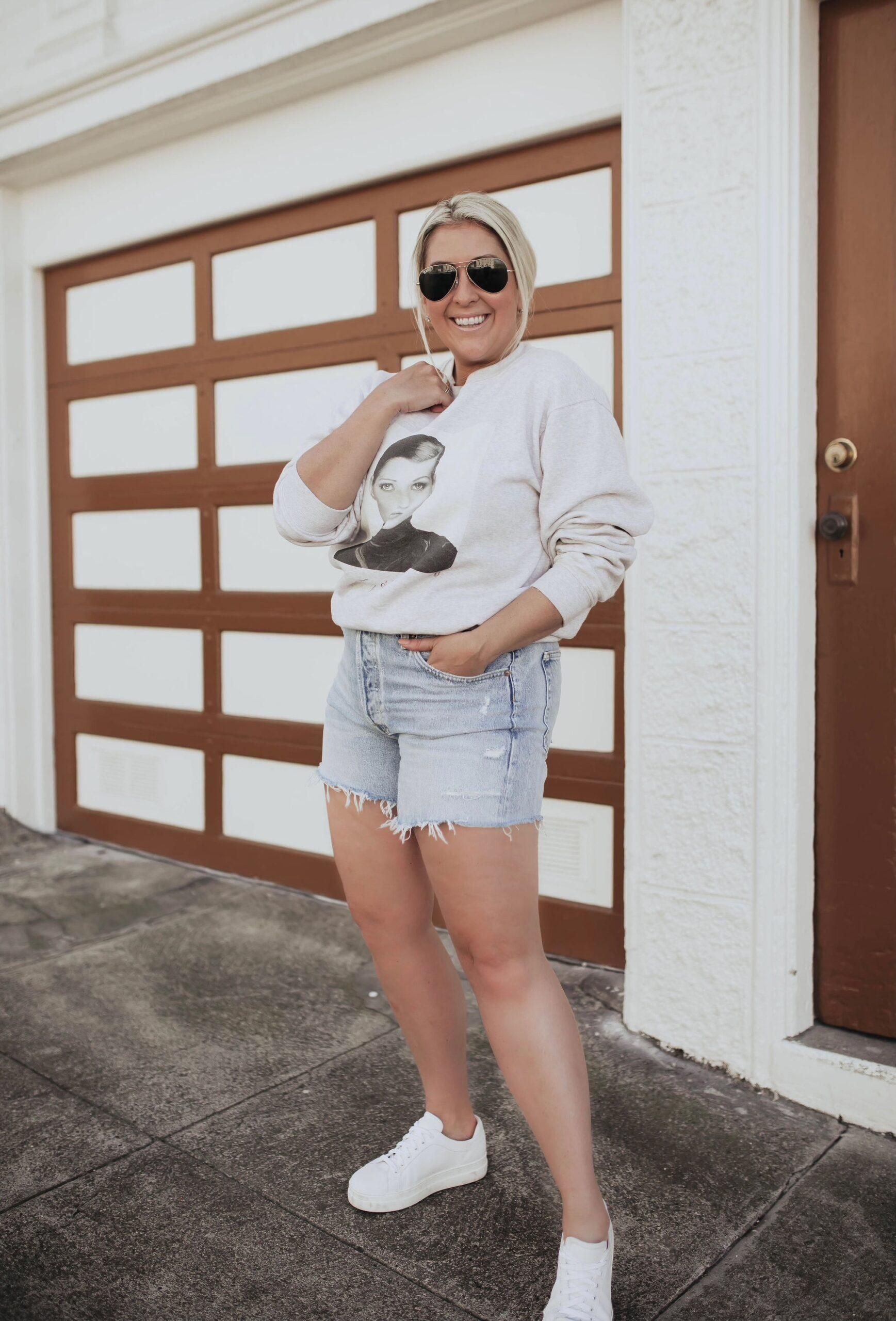 San Francisco fashion blogger KatWalkSF wears the Long Agolde Parker Shorts with an Anine Bing sweatshirt.
